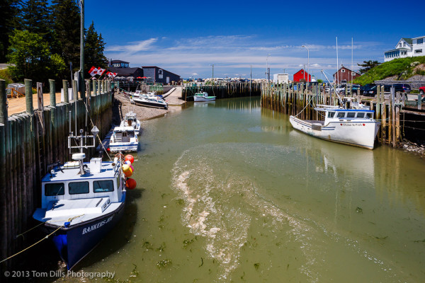 Tide coming in, boats starting to float.  Hall's Harbour, Nova Scotia