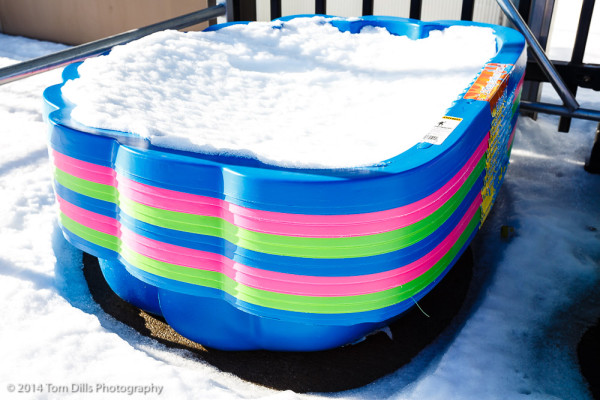 Kiddie pools at Walmart covered with snow - seasonal contrast