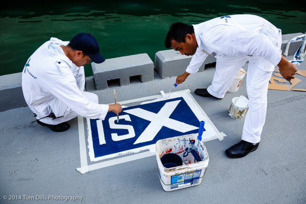 It is traditional for a ship's crew to paint the ship's logo on the dock the first time a ship visits a port.  This was Silhouette's first visit to San Juan, and these two guys were tasked with painting the logo.