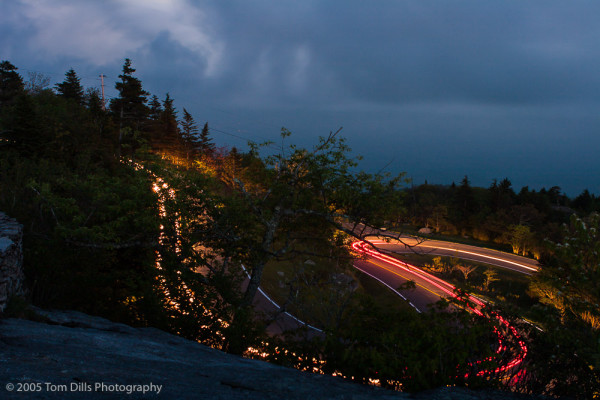 Car lights leave a trail on the descent from Grandfather Mountain, North Carolina