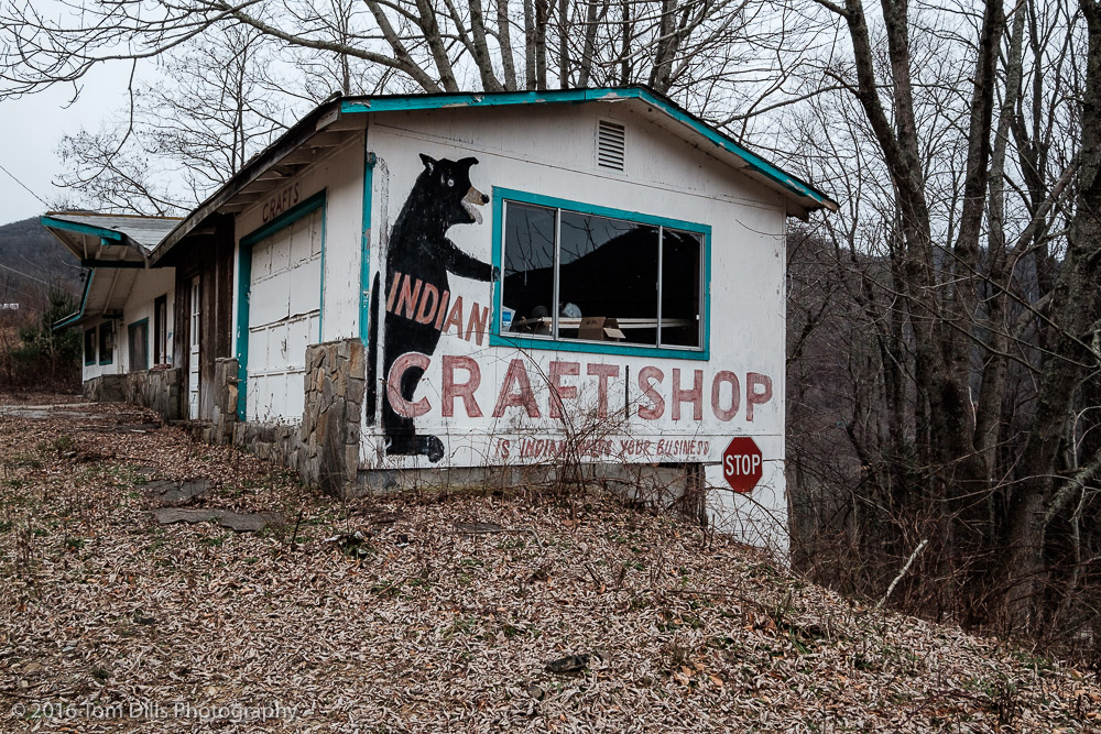 """This Indian Needs Your Business"" Vacant building along SR 19 between Maggie Valley and Soco Gap, North Carolina"