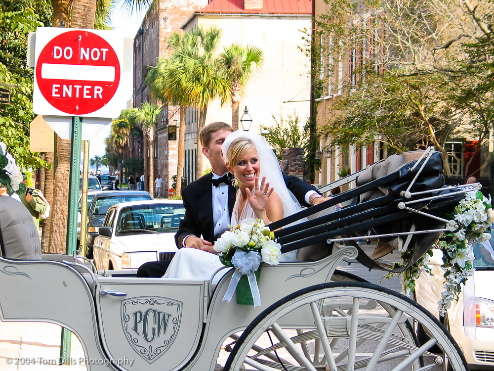 "Unfortunate Background, Charleston, South Carolina This is one of my favorite ""candid"" shots of all time, just because I love the ironic juxtaposition of the stop sign behind the just-married couple. I might have also called this ""Too Late."""