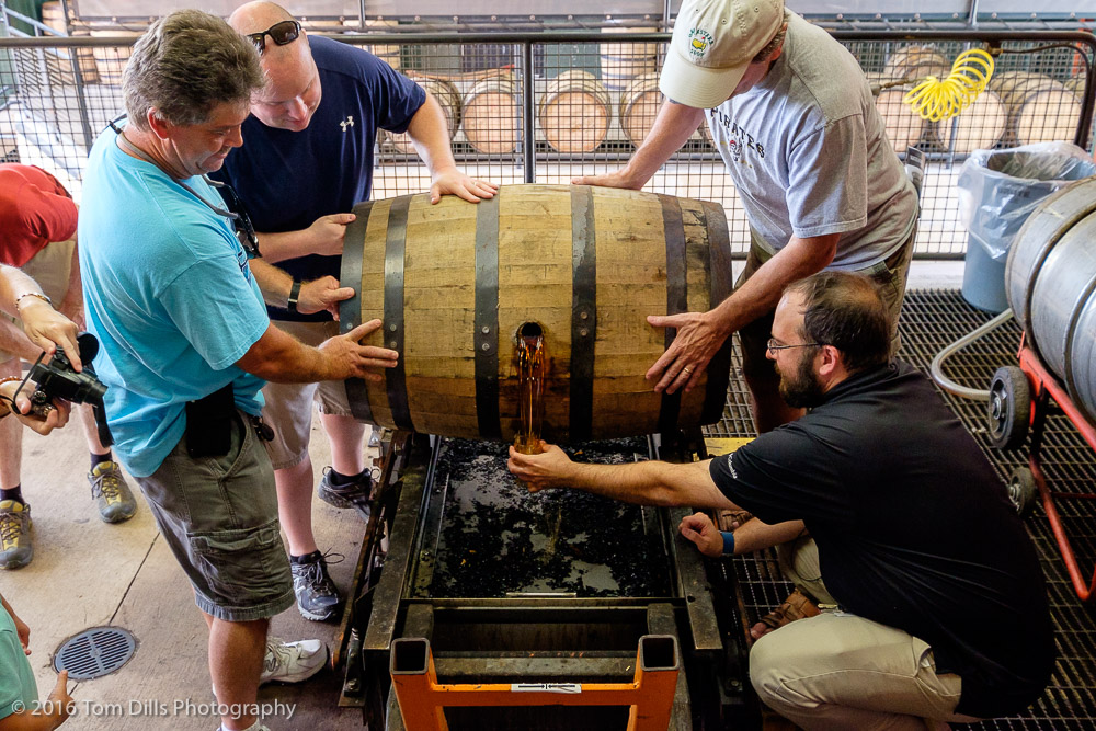 Demonstration of tasting the uncut Bourbon straight from the barrel. Jim Beam Distillery, Clermont, Kentucky